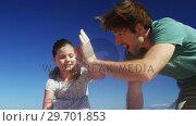Купить «Happy family giving high five to each other at beach», видеоролик № 29701853, снято 1 марта 2017 г. (c) Wavebreak Media / Фотобанк Лори