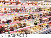 Купить «Showcase with different fresh sweet cakes ready to sale in hypermarket», фото № 29702313, снято 27 января 2018 г. (c) FotograFF / Фотобанк Лори