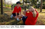 Купить «Kids performing stretching exercise in boot camp», видеоролик № 29702489, снято 16 марта 2017 г. (c) Wavebreak Media / Фотобанк Лори