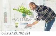Купить «Male executive working on laptop at desk», видеоролик № 29702821, снято 26 марта 2017 г. (c) Wavebreak Media / Фотобанк Лори