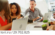 Купить «Team of executives interacting with each other while working in the office», видеоролик № 29702825, снято 26 марта 2017 г. (c) Wavebreak Media / Фотобанк Лори