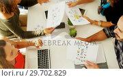 Купить «Team of executives interacting with each other while working in the office», видеоролик № 29702829, снято 26 марта 2017 г. (c) Wavebreak Media / Фотобанк Лори