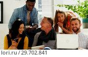 Купить «Business colleagues sitting together on a couch», видеоролик № 29702841, снято 26 марта 2017 г. (c) Wavebreak Media / Фотобанк Лори
