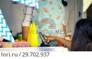 Купить «Woman paying bill through mobile phone», видеоролик № 29702937, снято 26 марта 2017 г. (c) Wavebreak Media / Фотобанк Лори