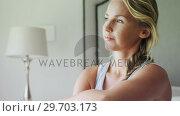Thoughtful woman sitting in bedroom 4k. Стоковое видео, агентство Wavebreak Media / Фотобанк Лори