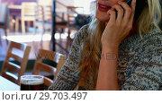 Купить «Woman talking on mobile phone while having beer at bar 4k», видеоролик № 29703497, снято 28 марта 2017 г. (c) Wavebreak Media / Фотобанк Лори