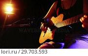 Купить «Woman singing song while playing electric guitar 4k», видеоролик № 29703593, снято 7 марта 2017 г. (c) Wavebreak Media / Фотобанк Лори