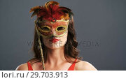 Купить «Portrait of beautiful woman wearing masquerade mask 4k», видеоролик № 29703913, снято 22 мая 2017 г. (c) Wavebreak Media / Фотобанк Лори