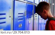 Купить «Sad schoolgirl leaning on lockers 4k», видеоролик № 29704013, снято 11 марта 2017 г. (c) Wavebreak Media / Фотобанк Лори
