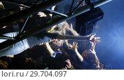 Купить «Crowd surfing at a concert 4k», видеоролик № 29704097, снято 7 марта 2017 г. (c) Wavebreak Media / Фотобанк Лори