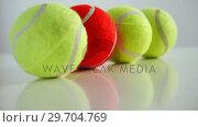 Купить «Tennis balls arranged in row 4k», видеоролик № 29704769, снято 6 апреля 2017 г. (c) Wavebreak Media / Фотобанк Лори