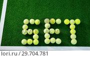 Купить «Tennis balls forming word set in court 4k», видеоролик № 29704781, снято 6 апреля 2017 г. (c) Wavebreak Media / Фотобанк Лори