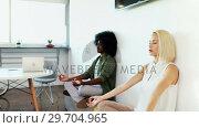 Купить «Executives doing yoga 4k», видеоролик № 29704965, снято 19 марта 2017 г. (c) Wavebreak Media / Фотобанк Лори