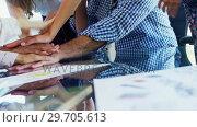 Купить «Group of executives forming hand stack 4k», видеоролик № 29705613, снято 19 марта 2017 г. (c) Wavebreak Media / Фотобанк Лори