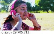 Купить «Woman listening to headphones 4k», видеоролик № 29705713, снято 9 марта 2017 г. (c) Wavebreak Media / Фотобанк Лори
