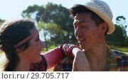Купить «Hipster couple smiling at each other 4k», видеоролик № 29705717, снято 9 марта 2017 г. (c) Wavebreak Media / Фотобанк Лори