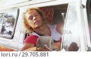 Купить «Man interacting while driving van 4k», видеоролик № 29705881, снято 9 марта 2017 г. (c) Wavebreak Media / Фотобанк Лори