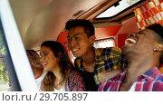 Купить «Friends enjoying in van 4k», видеоролик № 29705897, снято 9 марта 2017 г. (c) Wavebreak Media / Фотобанк Лори