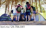 Купить «Friends walking towards the tent in park 4k», видеоролик № 29706041, снято 9 марта 2017 г. (c) Wavebreak Media / Фотобанк Лори
