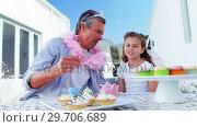 Купить «Smiling father and daughter in fairy costume having a tea party 4k», видеоролик № 29706689, снято 24 марта 2017 г. (c) Wavebreak Media / Фотобанк Лори