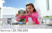 Купить «Girl in fairy costume pouring tea into cup 4k», видеоролик № 29706693, снято 24 марта 2017 г. (c) Wavebreak Media / Фотобанк Лори