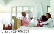 Купить «Family playing clapping games on bed in bedroom 4k», видеоролик № 29706709, снято 24 марта 2017 г. (c) Wavebreak Media / Фотобанк Лори