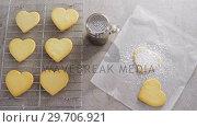 Raw heart shape cookies on baking tray with flour shaker strainer and wax paper 4k. Стоковое видео, агентство Wavebreak Media / Фотобанк Лори