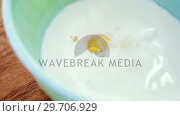 Купить «Raw cookie dough in bowl and plastic 4k», видеоролик № 29706929, снято 5 мая 2017 г. (c) Wavebreak Media / Фотобанк Лори