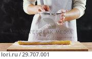 Купить «Woman icing sugar on dough 4k», видеоролик № 29707001, снято 5 мая 2017 г. (c) Wavebreak Media / Фотобанк Лори