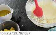 Купить «Woman adding butter cubes to batter in bowl 4k», видеоролик № 29707037, снято 5 мая 2017 г. (c) Wavebreak Media / Фотобанк Лори
