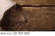 Купить «Cereal bran sticks spilling out of sack 4k», видеоролик № 29707065, снято 13 июня 2017 г. (c) Wavebreak Media / Фотобанк Лори