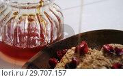 Купить «Honey pouring into a cereal bowl 4k», видеоролик № 29707157, снято 13 июня 2017 г. (c) Wavebreak Media / Фотобанк Лори