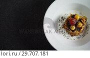 Купить «Granola bars with raspberry and golden berry in plate 4k», видеоролик № 29707181, снято 13 июня 2017 г. (c) Wavebreak Media / Фотобанк Лори