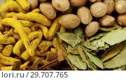 Купить «Nutmeg, bay leaf, cinnamon stick and turmeric 4k», видеоролик № 29707765, снято 5 июня 2017 г. (c) Wavebreak Media / Фотобанк Лори