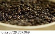 Купить «Black peppers in bowl 4k», видеоролик № 29707969, снято 5 июня 2017 г. (c) Wavebreak Media / Фотобанк Лори