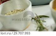 Rice in bowl with various spices 4k. Стоковое видео, агентство Wavebreak Media / Фотобанк Лори