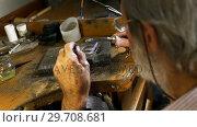 Купить «Goldsmith manufacturing jewellery in workshop 4k», видеоролик № 29708681, снято 10 июня 2017 г. (c) Wavebreak Media / Фотобанк Лори