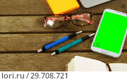 Купить «Laptop, sticky note, mobile phone, pen, organizer and spectacles on table 4k», видеоролик № 29708721, снято 16 мая 2017 г. (c) Wavebreak Media / Фотобанк Лори