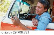 Купить «Man using mobile phone in camper van 4k», видеоролик № 29708781, снято 9 марта 2017 г. (c) Wavebreak Media / Фотобанк Лори