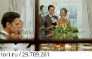 Купить «Bride and groom toasting their glasses with guests 4K 4k», видеоролик № 29709261, снято 2 мая 2017 г. (c) Wavebreak Media / Фотобанк Лори