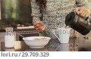 Купить «Happy woman wearing winter cloths pouring coffee in coffee mug 4K 4k», видеоролик № 29709329, снято 31 мая 2017 г. (c) Wavebreak Media / Фотобанк Лори