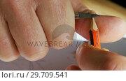 Купить «Craftsman sharpening pencil with a blade 4k», видеоролик № 29709541, снято 30 мая 2017 г. (c) Wavebreak Media / Фотобанк Лори