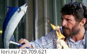 Купить «Craftsman polishing fish sculpture 4k», видеоролик № 29709621, снято 30 мая 2017 г. (c) Wavebreak Media / Фотобанк Лори