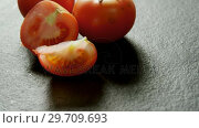 Купить «Full and half tomatoes arranged on grey background 4K 4k», видеоролик № 29709693, снято 12 июня 2017 г. (c) Wavebreak Media / Фотобанк Лори
