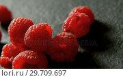 Купить «Raspberries on black background 4K 4k», видеоролик № 29709697, снято 12 июня 2017 г. (c) Wavebreak Media / Фотобанк Лори
