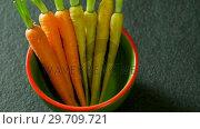 Купить «Carrots in a bowl 4k», видеоролик № 29709721, снято 12 июня 2017 г. (c) Wavebreak Media / Фотобанк Лори