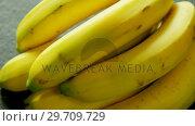 Купить «Bunch of fresh bananas 4k», видеоролик № 29709729, снято 12 июня 2017 г. (c) Wavebreak Media / Фотобанк Лори