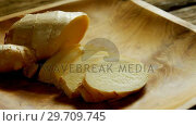 Купить «Sliced ginger in a plate 4k», видеоролик № 29709745, снято 12 июня 2017 г. (c) Wavebreak Media / Фотобанк Лори