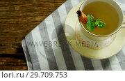 Купить «Herbal tea with cinnamon sticks and herb on a cloth 4k», видеоролик № 29709753, снято 12 июня 2017 г. (c) Wavebreak Media / Фотобанк Лори