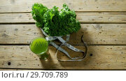 Купить «Green tea with leafy vegetable and measuring tape 4k», видеоролик № 29709789, снято 12 июня 2017 г. (c) Wavebreak Media / Фотобанк Лори